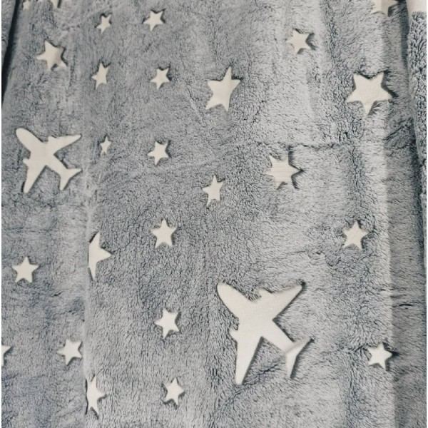 Glowing blanket with stars and planes